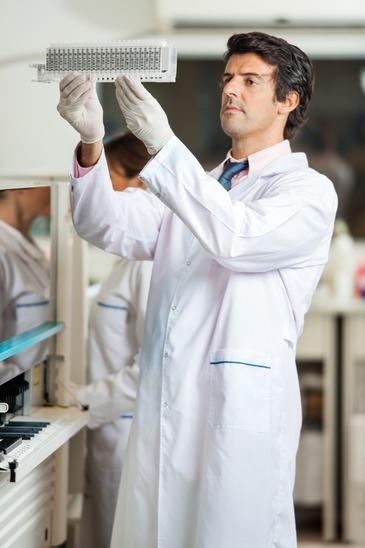 Researcher Examining Samples